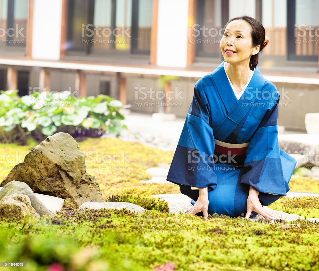 Mature Japanese woman looks up in wonderment stock photo