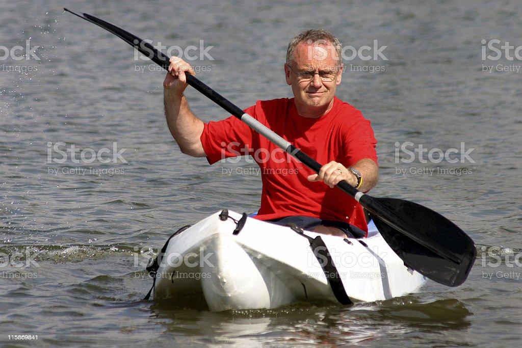 Mature kayaking royalty-free stock photo