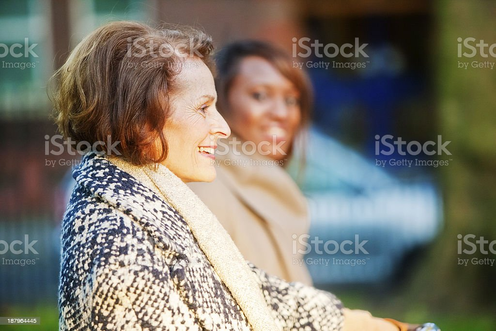 Mature lady and coloured woman promenading. royalty-free stock photo