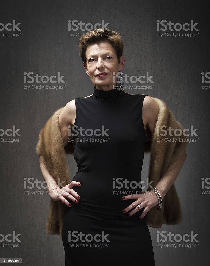 mature lady fashion portrait with fur on shoulders stock photo