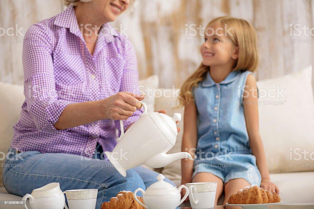 Mature lady having breakfast with her grandchild stock photo
