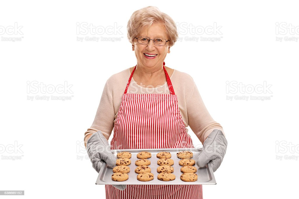 Mature lady holding homemade cookies stock photo
