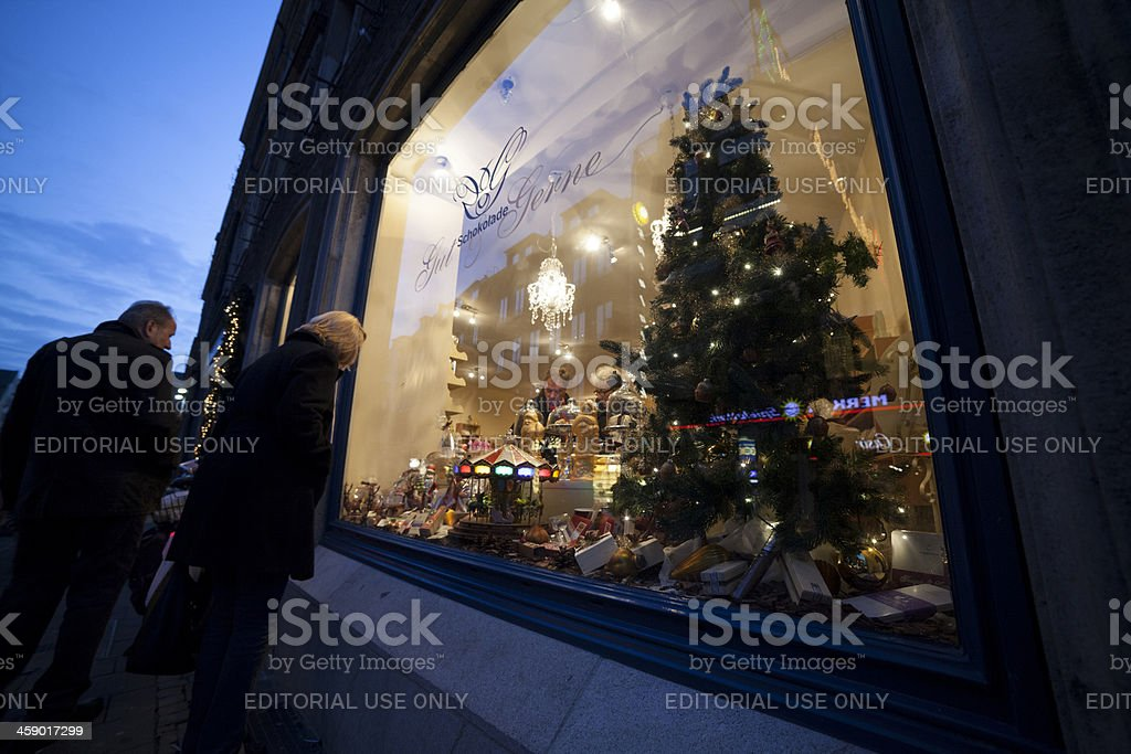 Mature lady looking at the Gut & Gerne window display. royalty-free stock photo