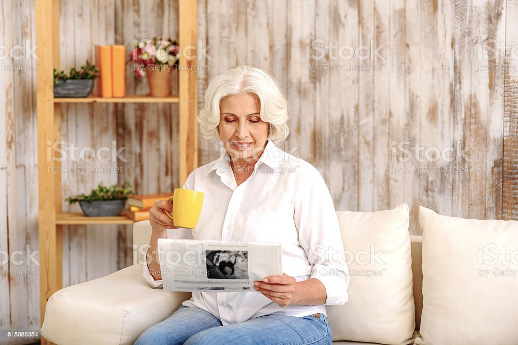 Mature lady relaxing at home stock photo