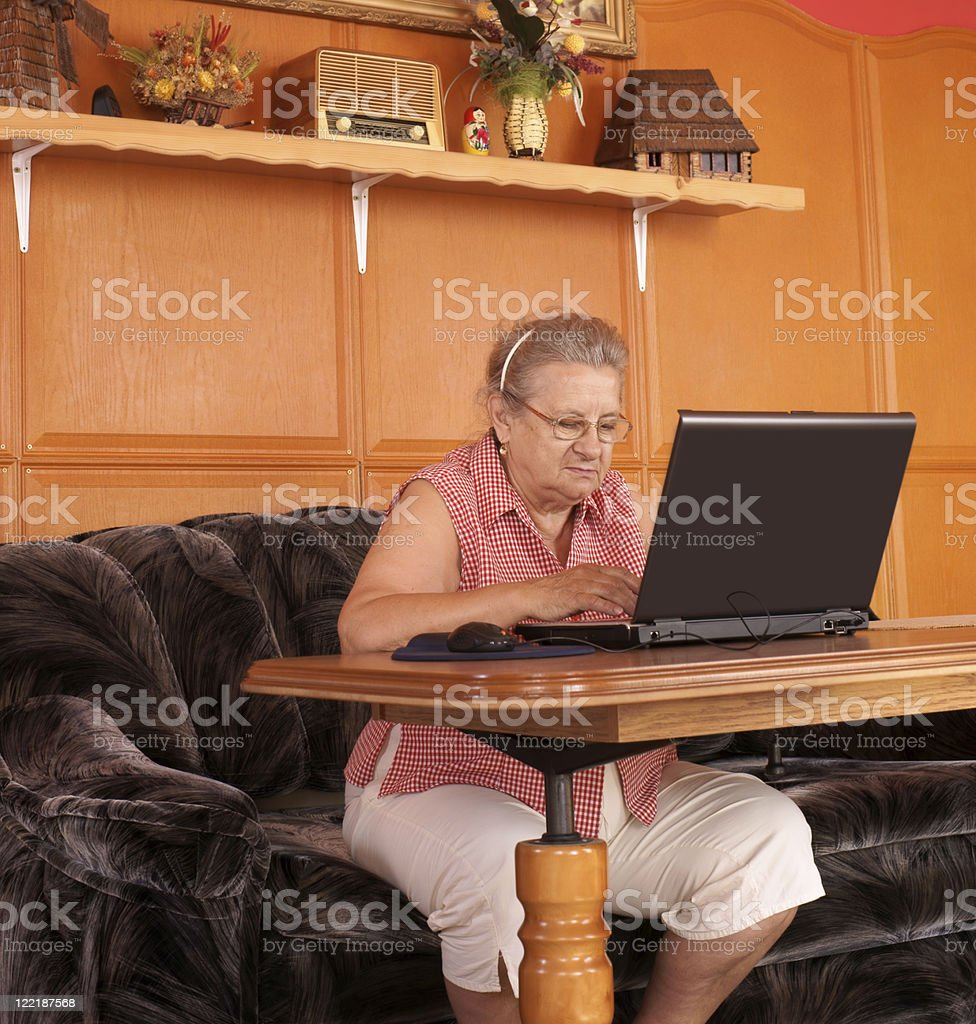 Mature Lady with laptop royalty-free stock photo