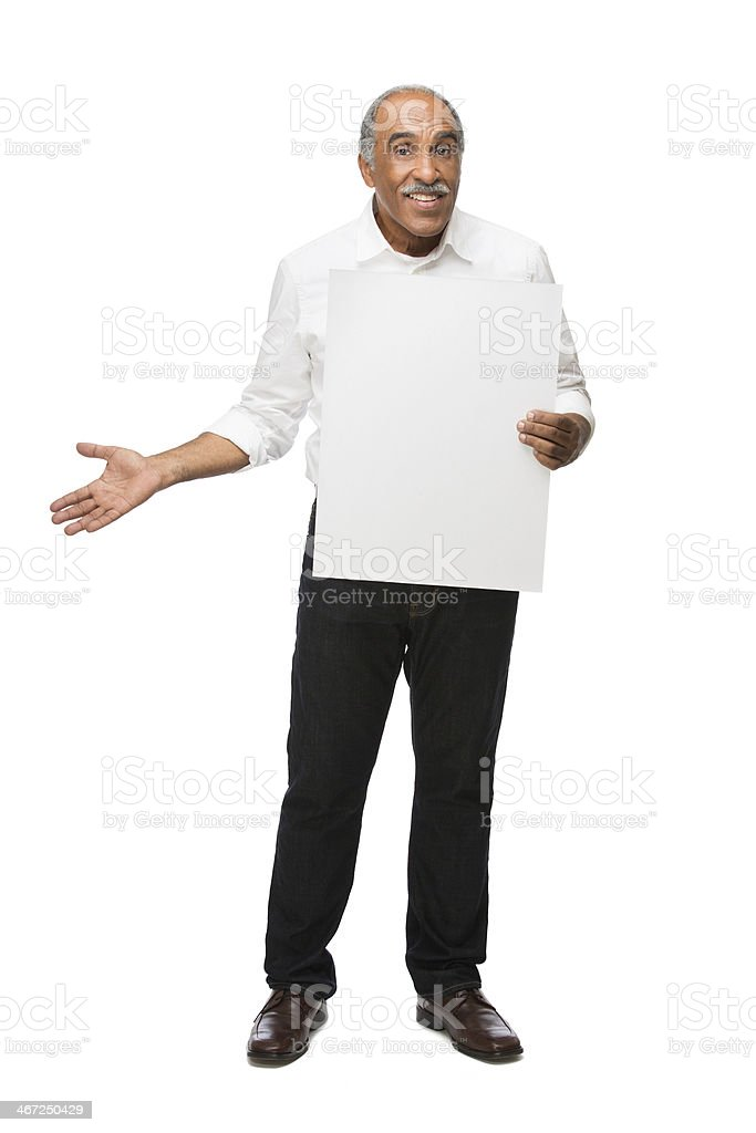 Mature latin man holding up sign royalty-free stock photo