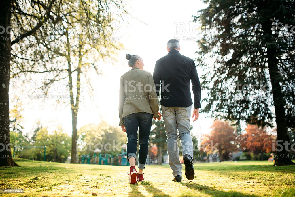 Mature Loving Couple Walking stock photo