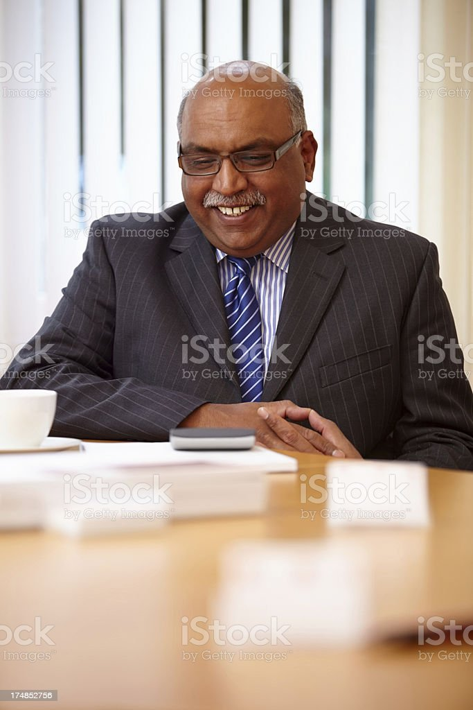 Mature male business consultant smiling royalty-free stock photo