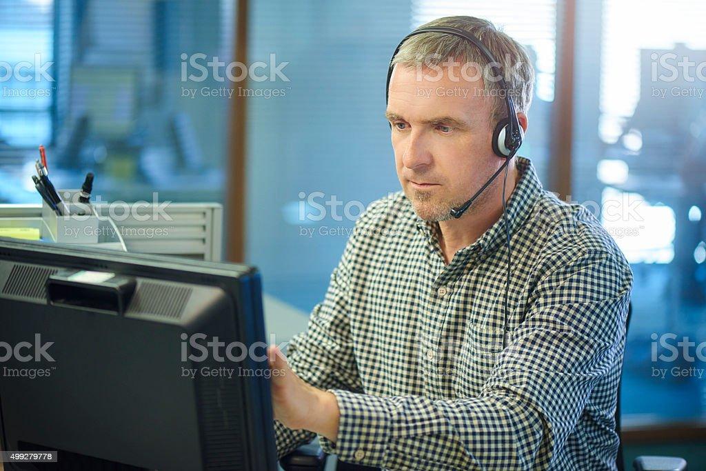 mature male call centre call handler stock photo