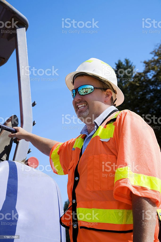 Mature male Construction Project Manager safety gear orange yellow royalty-free stock photo