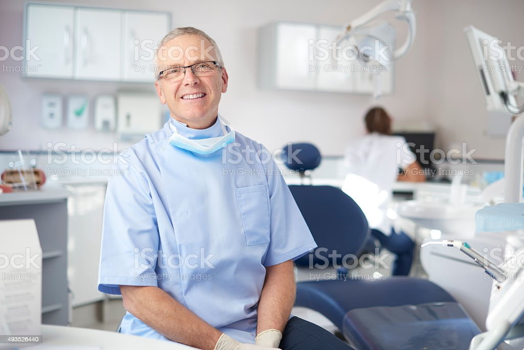 mature male dentist portrait stock photo