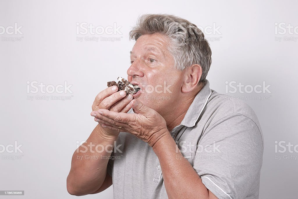 mature male eating messy cake royalty-free stock photo