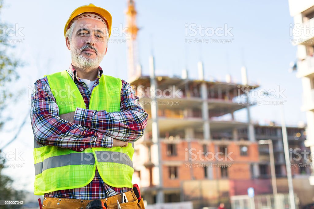 Mature male engineer at a construction site royalty-free stock photo