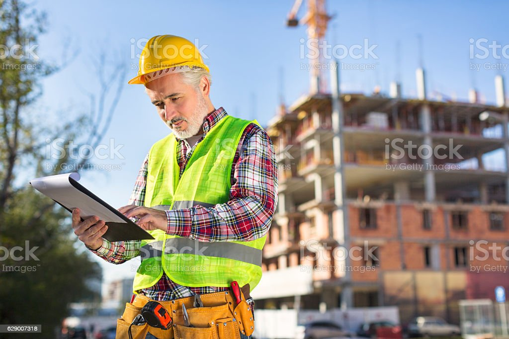 Mature male engineer looking at the papers royalty-free stock photo