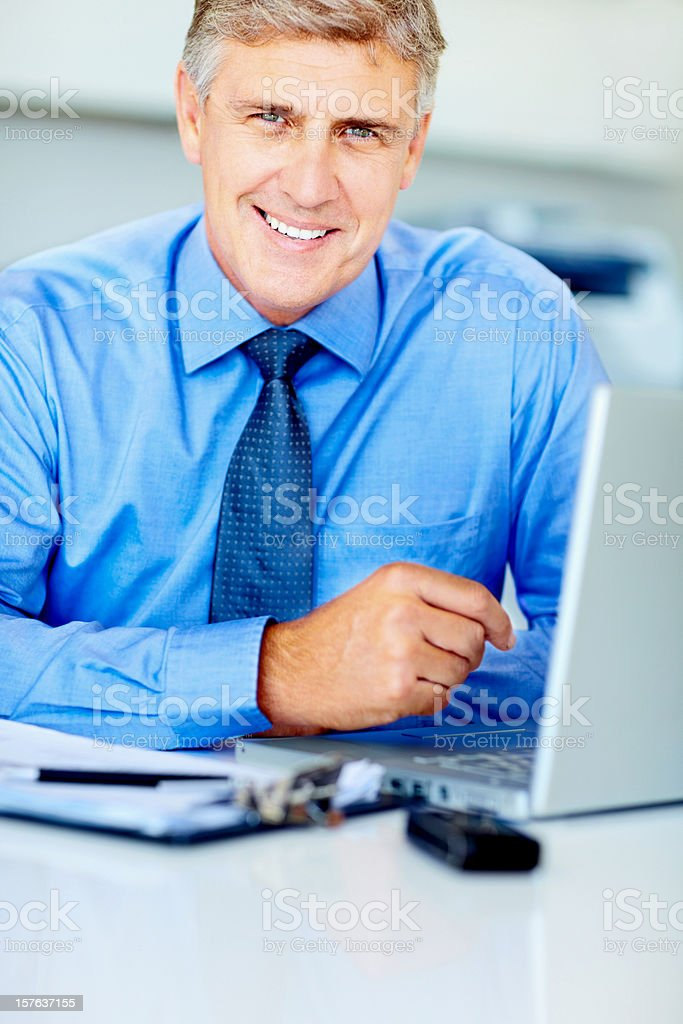 Mature male executive with laptop at work royalty-free stock photo