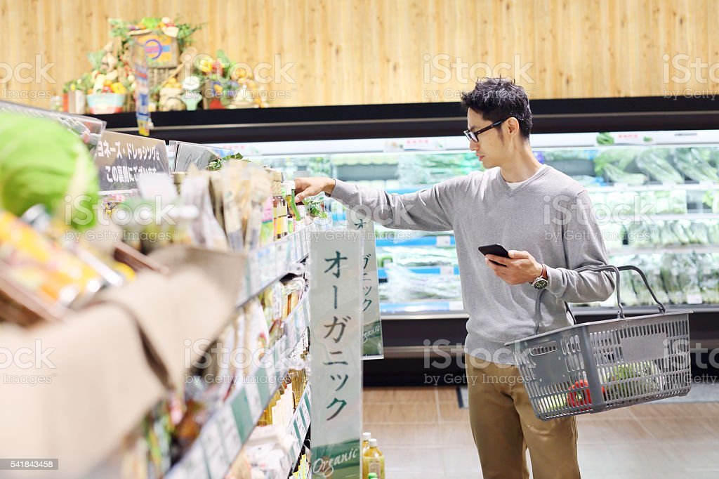 Mature male grocery shopping stock photo