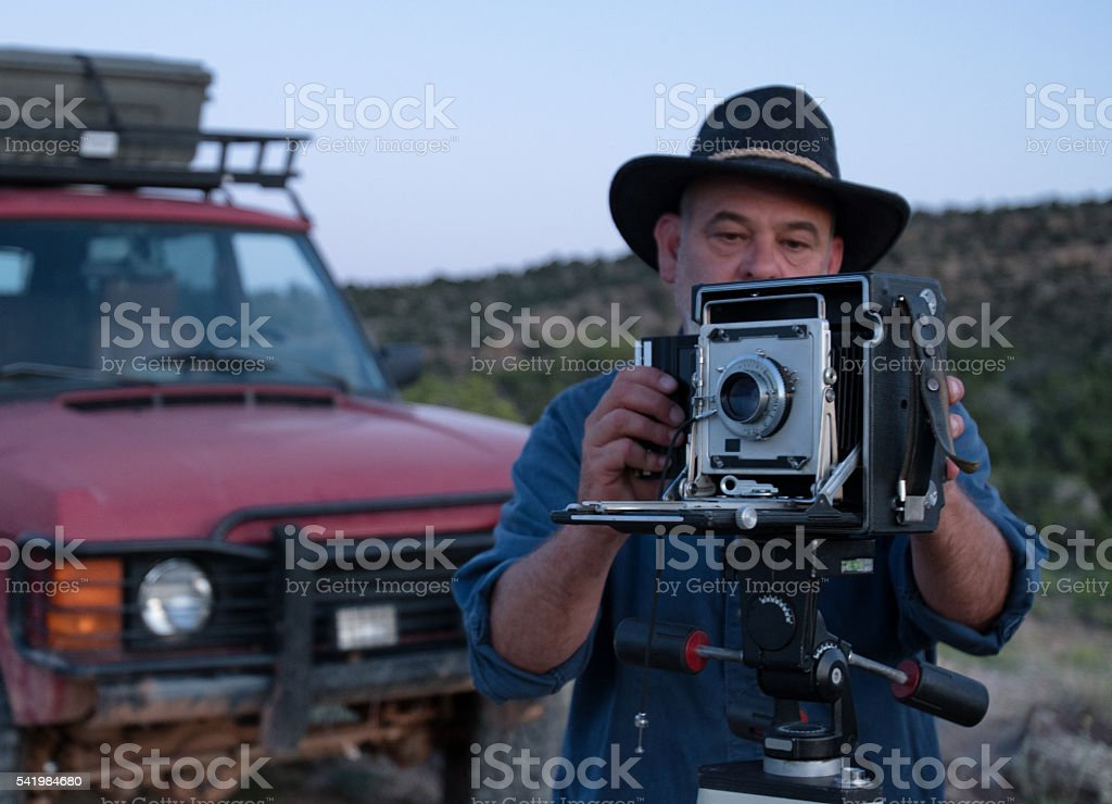 Mature Male Photographer with Medium Format Camera stock photo