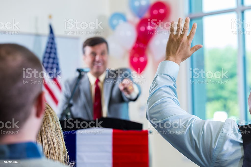 Mature male politician speaks at rally stock photo