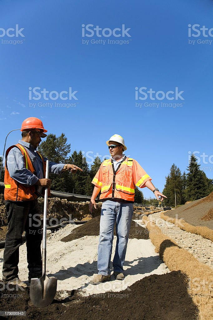 Mature male Project Manager overseeing Erosion control safety gear orange stock photo
