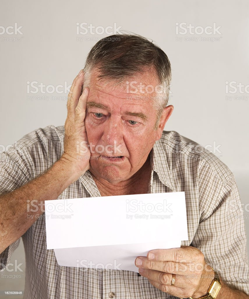 Mature male reacts to final notice. royalty-free stock photo