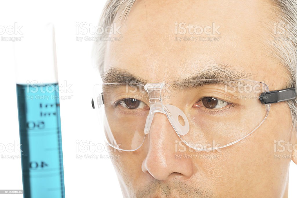 Mature Male Scientist Looking At Chemical royalty-free stock photo