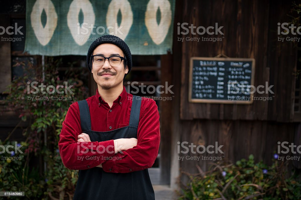 Mature male wearing an apron stock photo