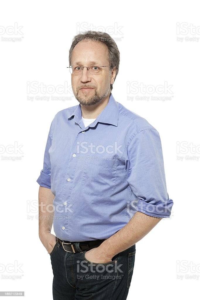 Mature male worker with hands in pockets royalty-free stock photo