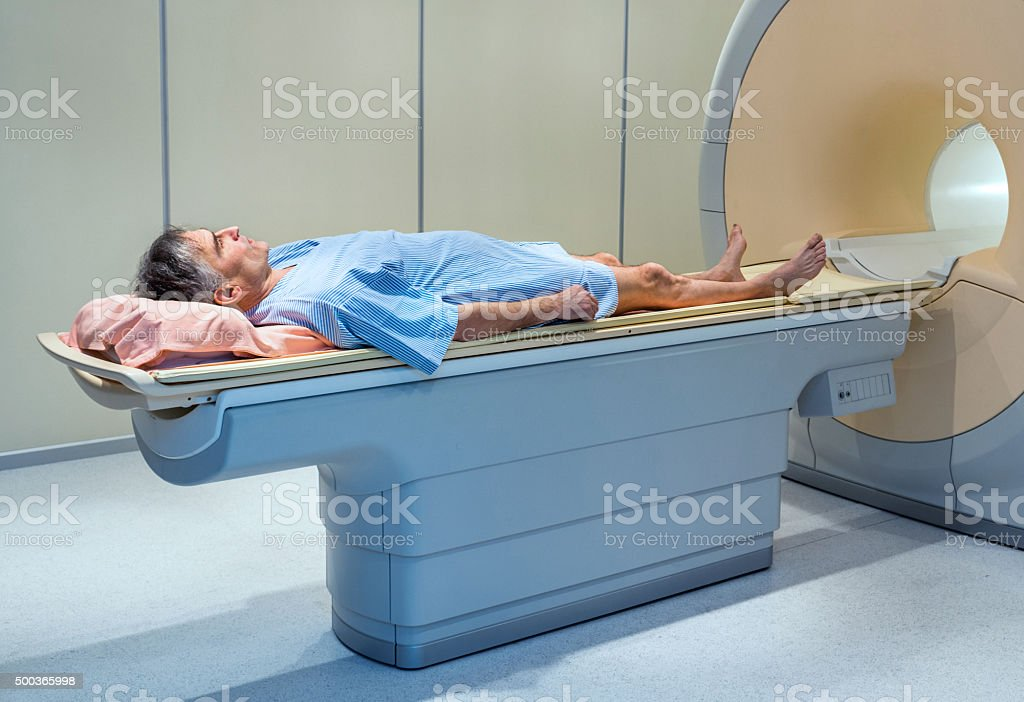 Mature man about to receive MRI Scan. stock photo