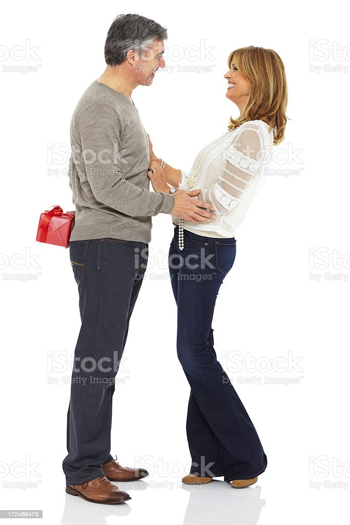 Mature man about to surprise his girlfriend with a gift royalty-free stock photo
