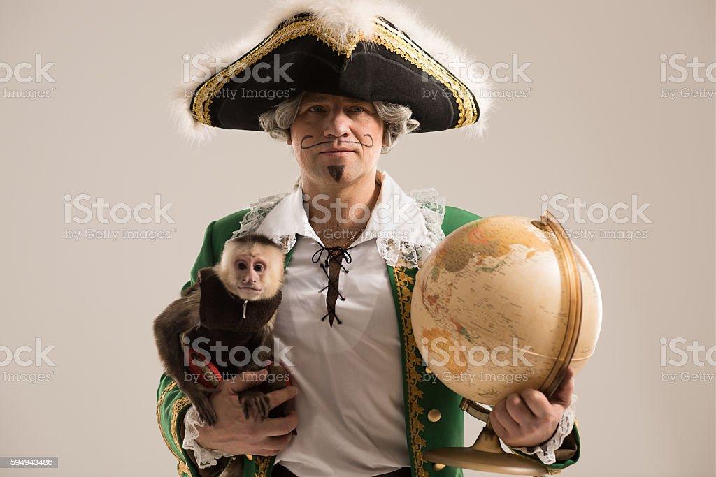Mature man adventurer with his monkey companion stock photo