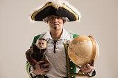 Mature man adventurer with his monkey companion