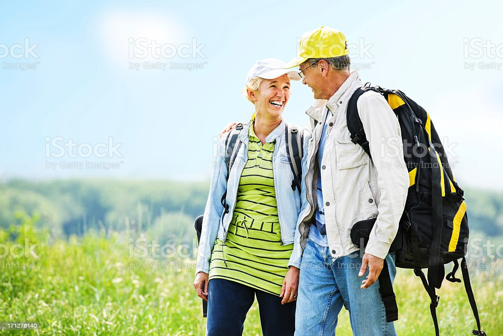 Mature man and woman tourists enjoying in the park. royalty-free stock photo