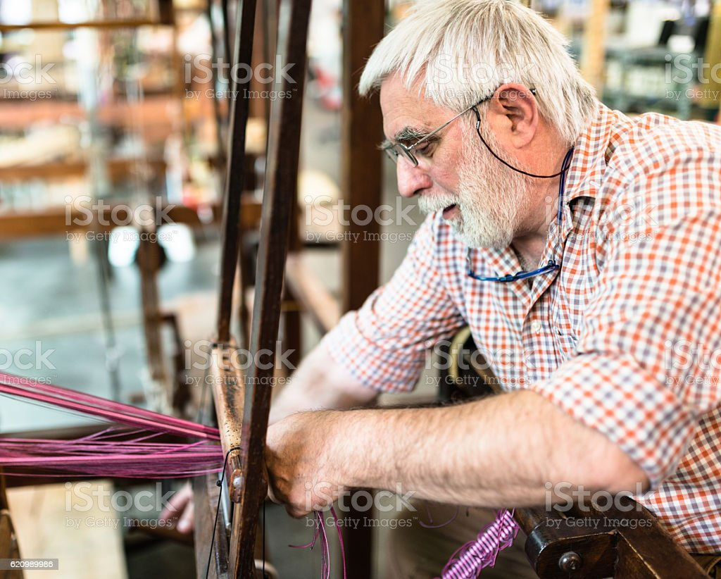 mature man artisan working on his products stock photo
