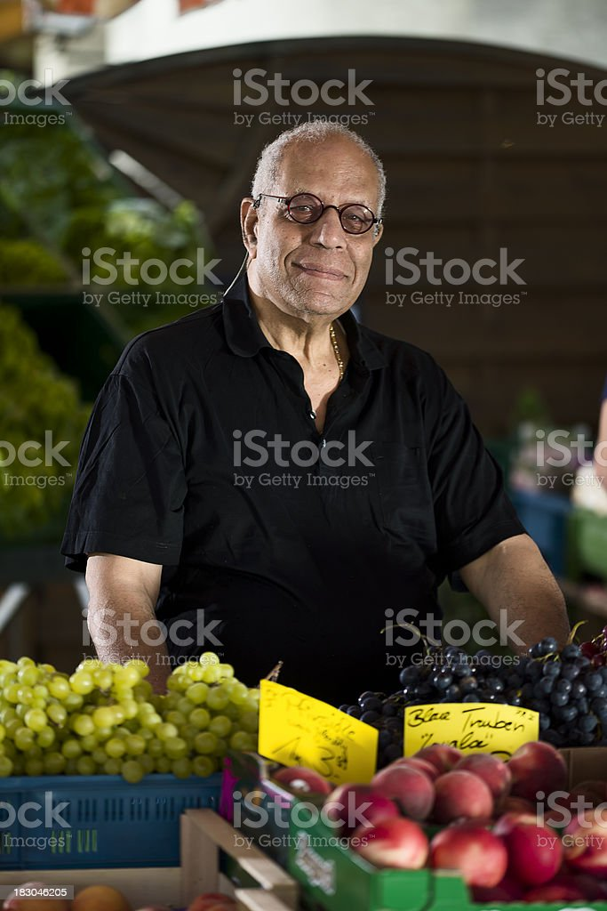 Mature Man at an Outdoor Market royalty-free stock photo