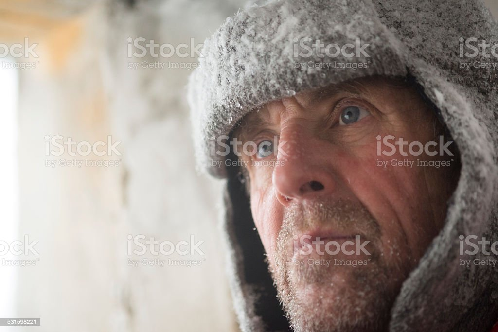 Mature Man at Great War's Bunker Porthole , Snowing, Alps, Europe stock photo