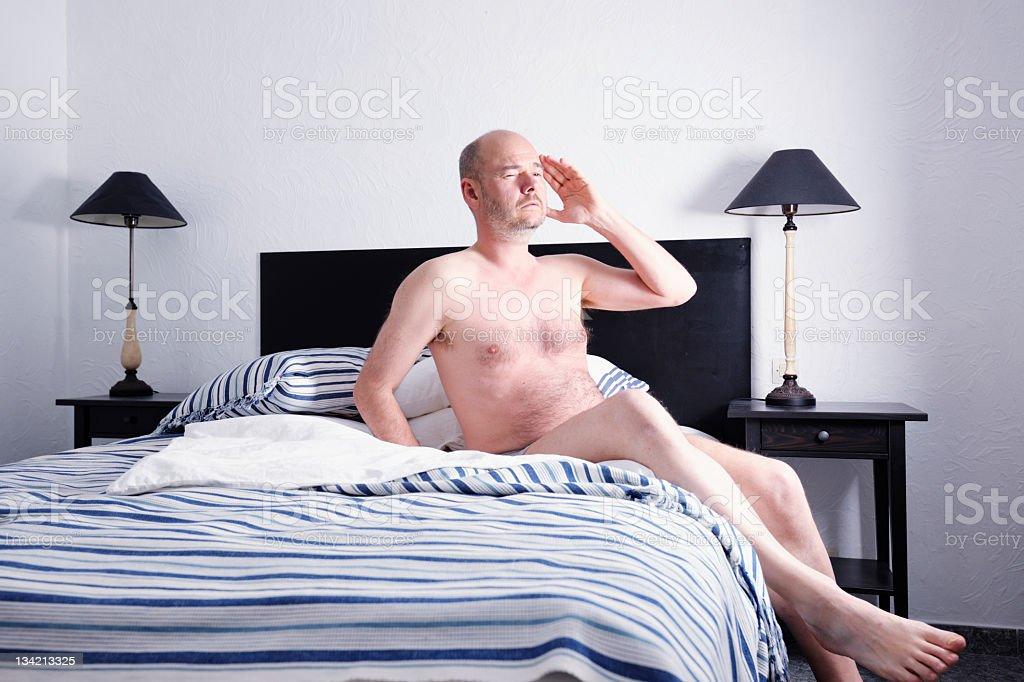 Mature Man Awaking with Headache stock photo