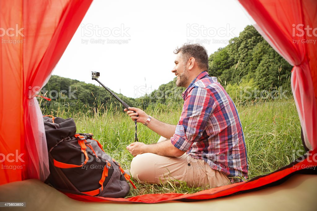 Mature man camping in the forest. stock photo