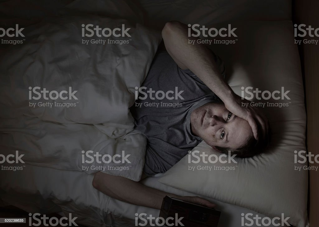 Mature man cannot fall asleep during night time stock photo