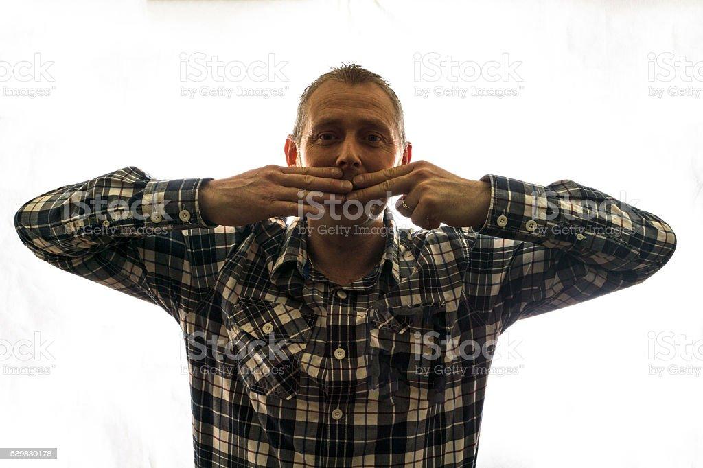 Mature man check shirt speak no evil stock photo