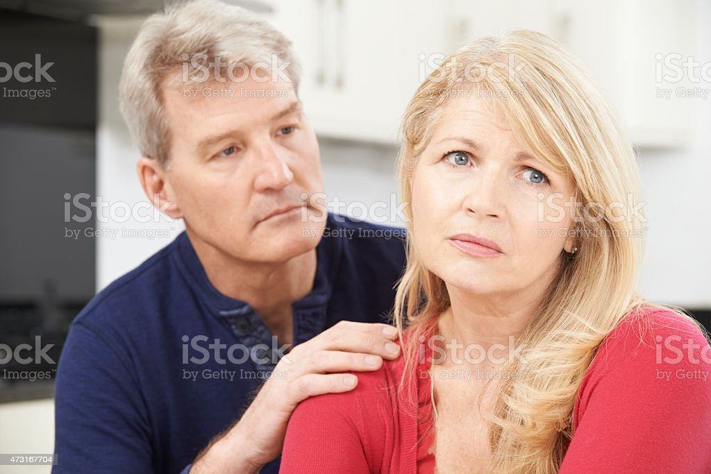 Mature Man Comforting Woman With Depression stock photo