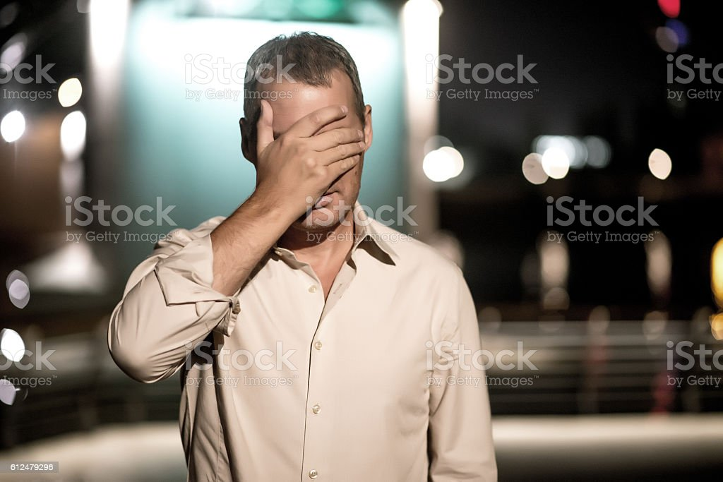 Mature man depressed and despaired  standing by night stock photo