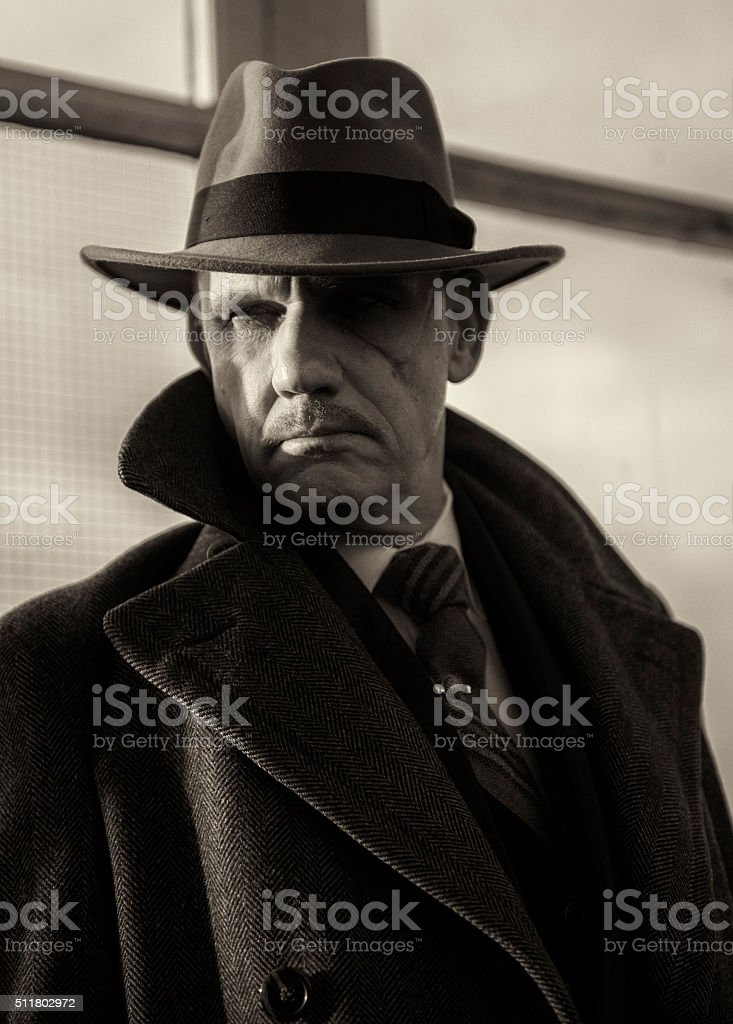 Mature man dressed as a 1940s gangster character. stock photo