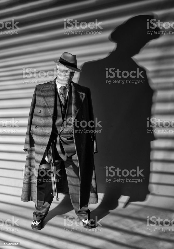 Mature man dressed as a 1940s gangster stock photo