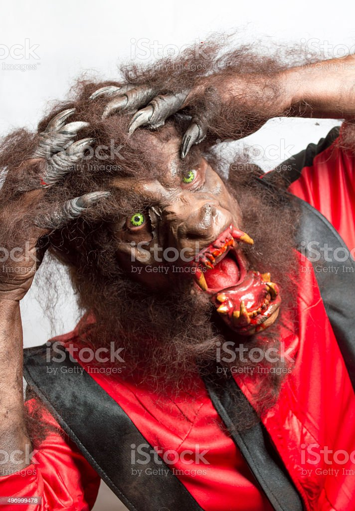 Mature man dressed as a werewolf with a white background stock photo