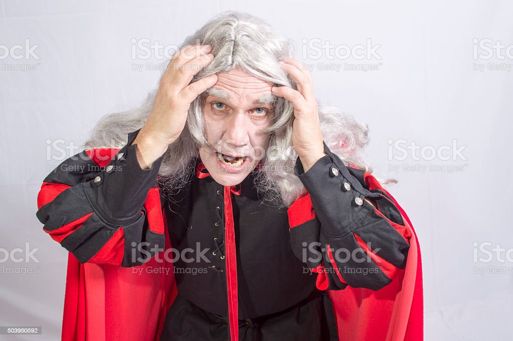 Mature man dressed as Hamlet acting stock photo