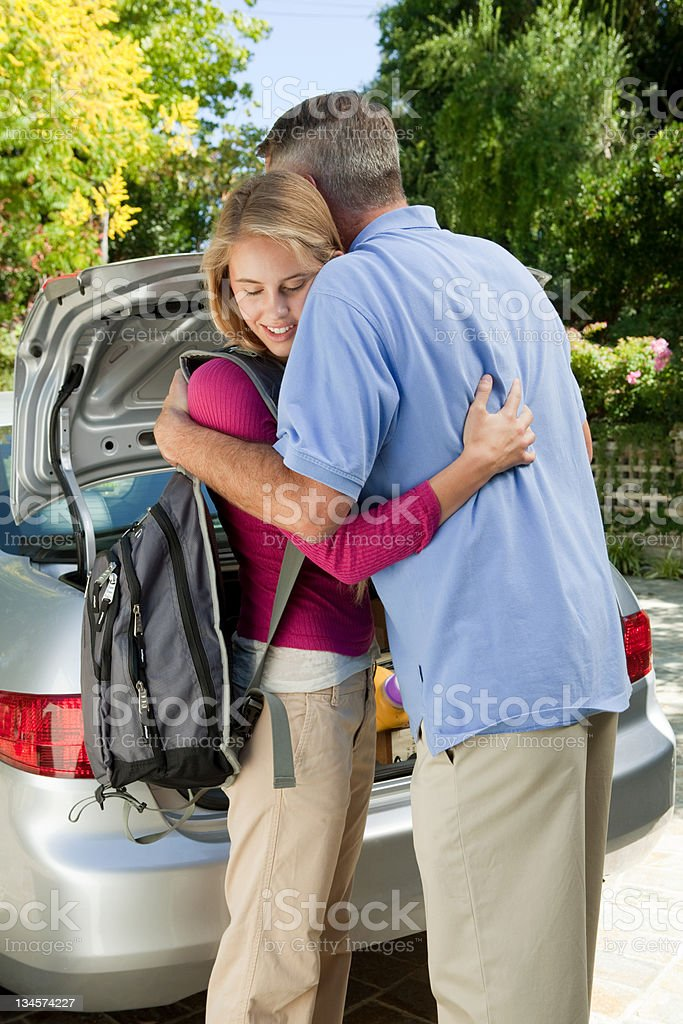 Mature man embracing daughter stock photo