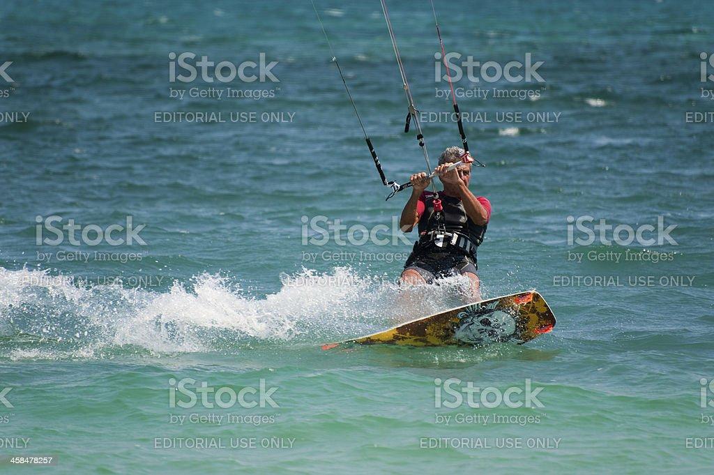 Mature man enjoy kite boarding stock photo