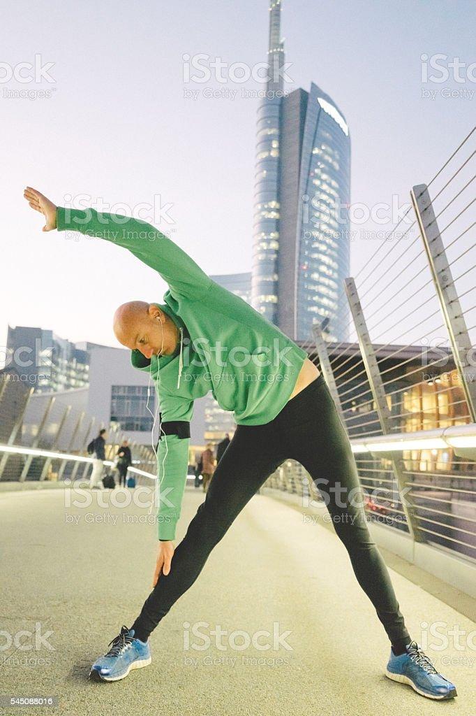 Mature Man Exercising Outdoors, Cityscape On Background stock photo