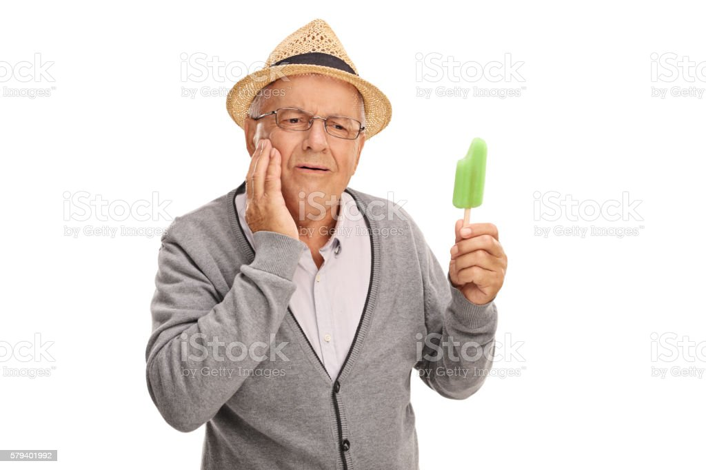 Mature man experiencing tooth ache stock photo