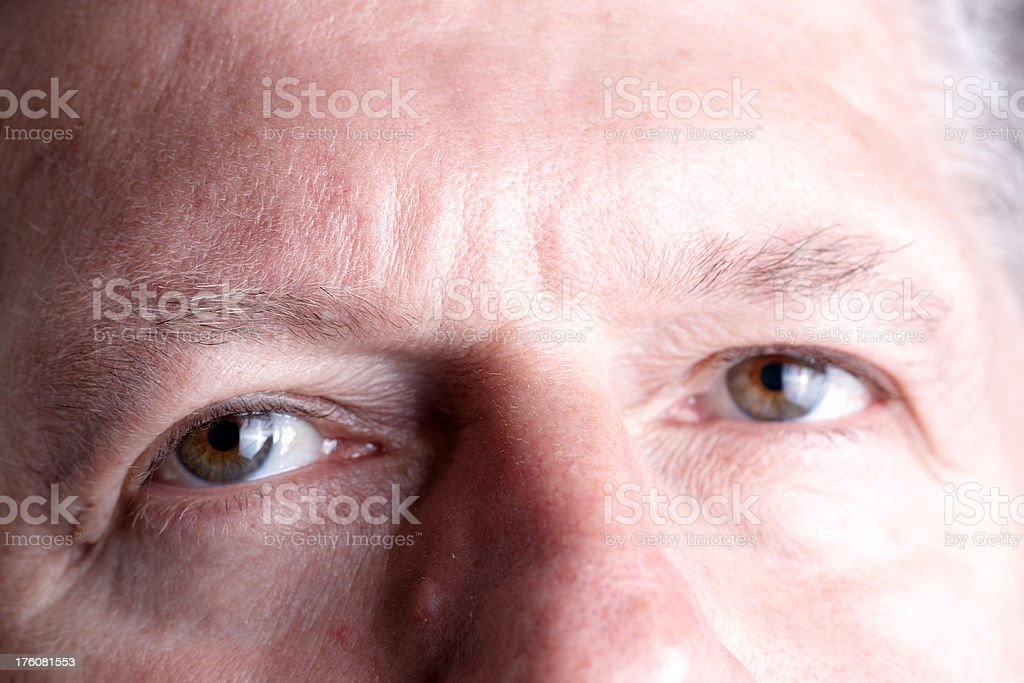 Mature man eye closeup stock photo